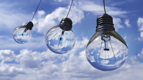 image of light bulbs against sky and cloud background